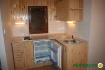 Větší chatka kuchyň